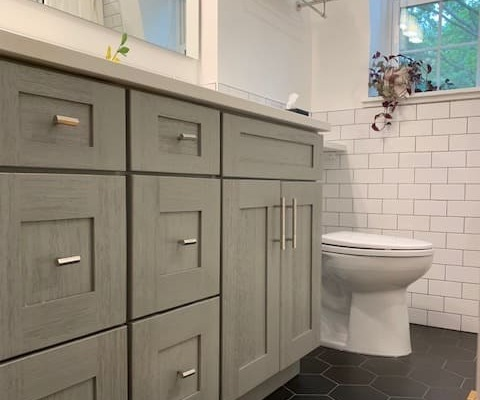 Luxurious Bathroom remodel with hexagon floor tile and subway wall tile