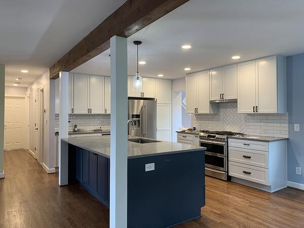 Kitchen remodel with white cabinets and blue island in virginia
